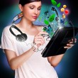 Poster portrait of young beautiful woman holding her universal device - tablet pc. Lots of things are appearing from the display. Universality of modern devices concept — Stock Photo #9248806