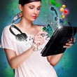 Poster portrait of young beautiful woman holding her universal device - tablet pc. Lots of things are appearing from the display. Universality of modern devices concept — Stock Photo #9248817