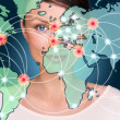 Attractive brunette young woman in futuristic interface standing in front of world map with glowing hot points location and connection lines — Stock Photo #9248831