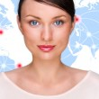 Portrait of young pretty woman looking at camera and standing in front of world map with glowing connection lines and server location points. Global Internet communications technology — Stock Photo #9248839