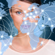 Portrait of young pretty woman looking at camera and standing in front of world map with glowing connection lines and server location points. Global Internet communications technology - Foto Stock