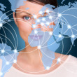 Постер, плакат: Portrait of young woman standing in front of big world map and looking at camera Server locations and actual online connections are displayed on virtual map Hosting provider concept