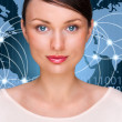 A businesswoman is using the internet. A map of the Earth with glowing points of locations and lines of connections and technology images in the background — Stock Photo