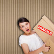 Close-up portrait of a young woman with boxes — Stock Photo