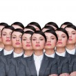 Many identical businesswomen clones. Businesswoman production concept. Army of workers ready for your business — Stock Photo #9249166