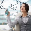 Stock Photo: Beautiful businesswoman thinking about something while drinking cool fresh mineral water at her office. Blank cloud balloon overhead