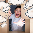 Portrait of young woman surrounded by lots of boxes. Lots of work concept. Help needed. Blank cloud balloons overhead — Stock Photo