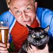 Artistic portrait of young man and his cat both looking at camera — Stock Photo