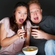 A couple watching a scary movie and it scared them so much that they are screaming — Stock Photo