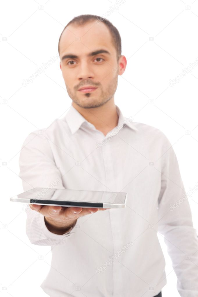 Handsome casual young man holding a touch pad tablet pc on isolated white background — Stock Photo #9247735