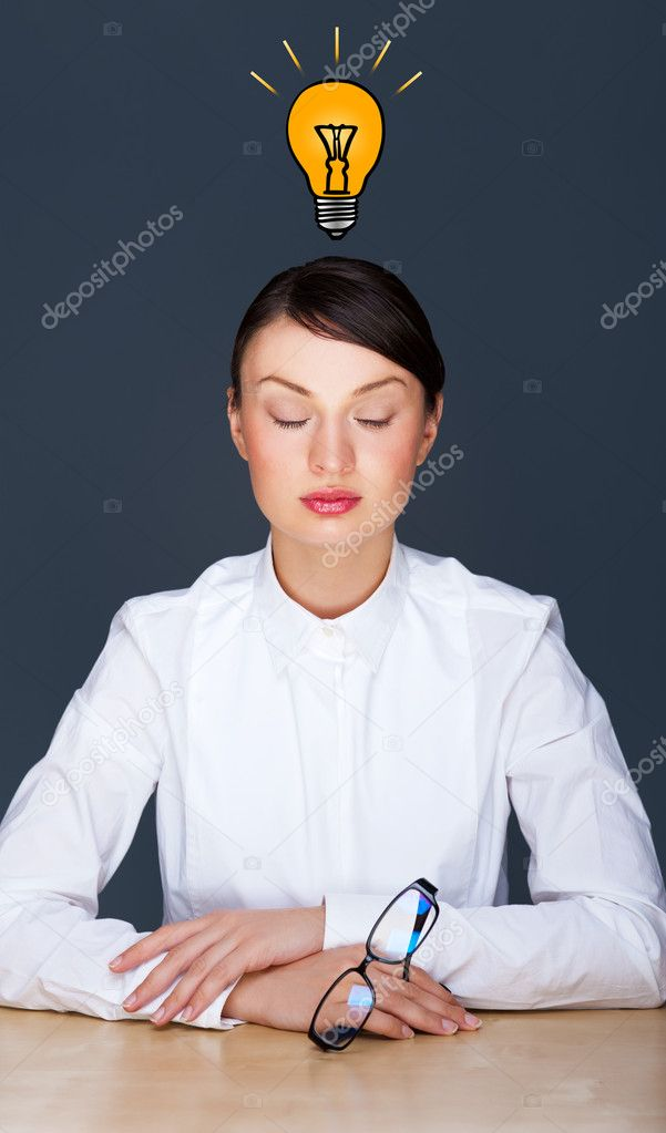 Idea woman - brainstorming. Formal beautiful young businesswoman sitting calm at her office. Graphic lamp - symbol of new idea, overhead  Stock Photo #9249249