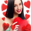 Young pretty attractive smiling woman with with soft heart toy. Holding Love Symbol and smiling — Stock Photo #9254408