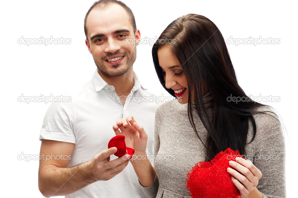 Portrait of handsome young man proposing marriage to a beautiful woman isolated on white background  Stock Photo #9254621