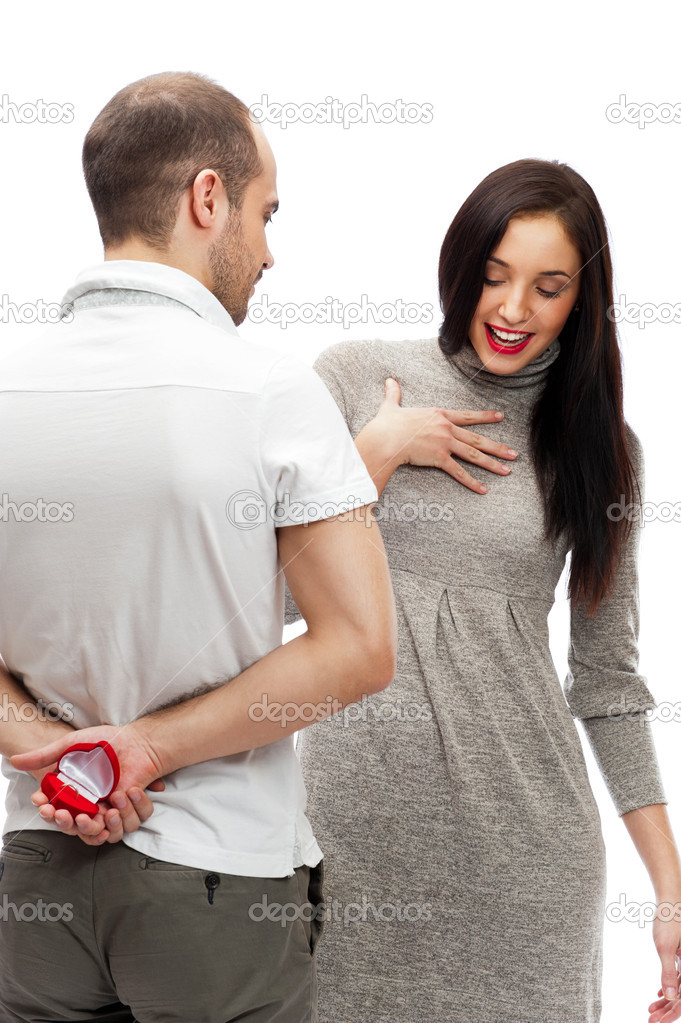 Portrait of handsome young man proposing marriage to a beautiful woman isolated on white background — Stock Photo #9254643