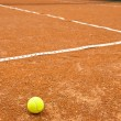 Detail of a clay court with tennis ball — Stock Photo #9270408
