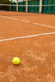 Detail of a clay court with tennis ball — Stock Photo