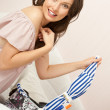 Portrait of young woman preparing for big trip and vacation she can not wait and have a big fun with packing her props and clothes — Stock Photo