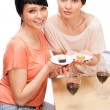 Cheerful Women eating sushi rolls and drinking red wine — Stock Photo #9371572