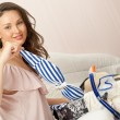 Stock Photo: Portrait of young woman preparing for big trip and vacation she can not wait and have a big fun with packing her props and clothes