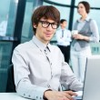 Portrait of confident business man and his colleagues at the office. Lots of copyspace — Stock Photo #9495349