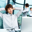 Stock Photo: Portrait of confident business man and his colleagues at the office. Lots of copyspace