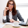 Adult young pretty business woman working at her office — Stock Photo #9579527