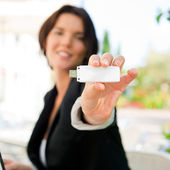 Young business woman using wireless internet connection with 3g — Stock Photo
