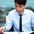 Portrait of a business man working at his office with papers — Stock Photo #9732504