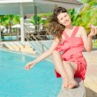 Beautiful young woman at a pool — Stock Photo #9812421