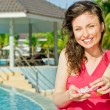 Beautiful young woman at a pool — Stock Photo #9812455