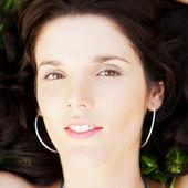 Pretty brunette woman wearing elegant dress relaxing outdoor in — Stock Photo
