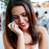 Closeup portrait of a pretty young female sitting at cafe in mor — Stock Photo