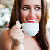 Closeup portrait of a pretty young female having a cup of coffee — Stock Photo