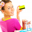 Beautiful shopping woman happy holding shopping bags and credit or discount card — Stock Photo