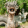 Stone Dragon Statue at Buddha Temple - Dalat, Vietnam - Stock Photo
