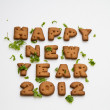 Stock Photo: Happy New Year 2012 Biscuits And Leaves