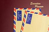 Plánovač a žluté obálky — Stock fotografie