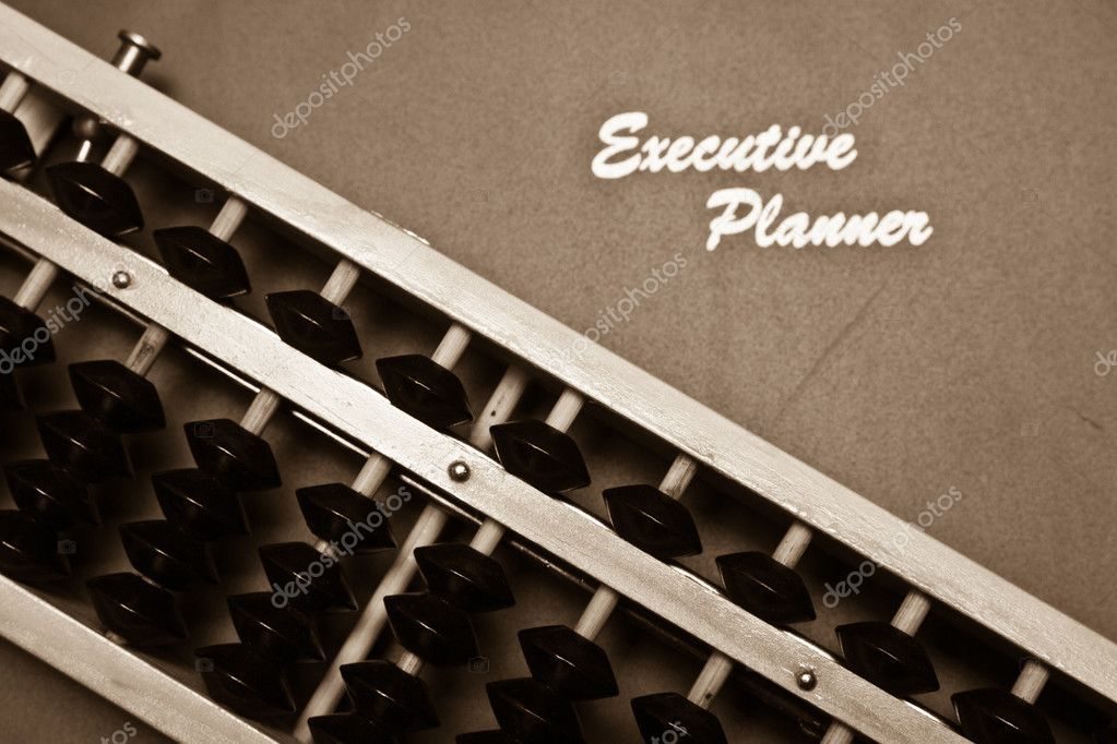 Excutive planner and traditional abacus in sepia tone — Stock Photo #8416270