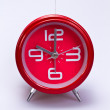 Stock Photo: Red Clock on White Surface