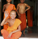 Cambodian Monk waves and smiles — Stock Photo