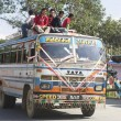 Overcrowded Bus in Kathmandu - Stock Photo