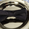 Stock Photo: Bowtie rest on golden tray