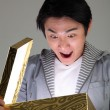 Surprised man opening a glowing box — Stock Photo #8017791
