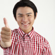 Man showing thumbs up sign with smiling — Stock Photo