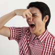 Young man pressing his nose — Stock Photo