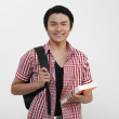 Young man standing and holding books — Stock Photo #8017923