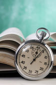 Stop watch in front of the book — Stock Photo