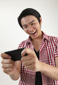 :man enjoy playing games on the smartphone — Stock Photo