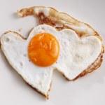 Heart shape fried egg — Stock Photo