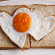 Love shape fried egg — Stock Photo